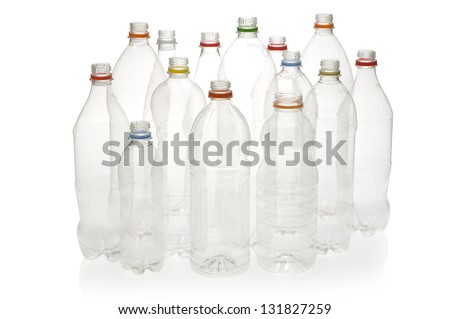 Empty plastic drinking bottles ready for recycling. - stock photo