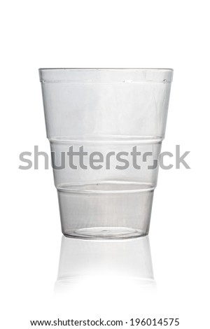 Empty plastic glass on white background. - stock photo