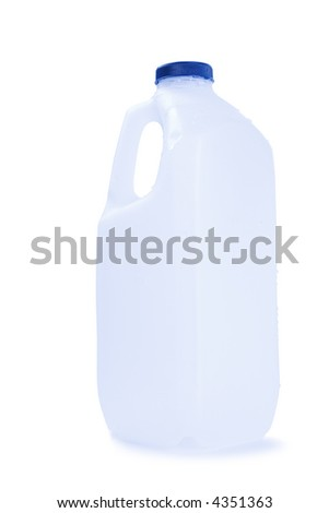 Empty plastic milk bottle, slightly blue tone, washed and ready for recycling. A few drops of water clinging to sides. - stock photo