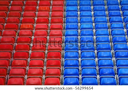 Empty plastic seats at stadium, sports arena. - stock photo