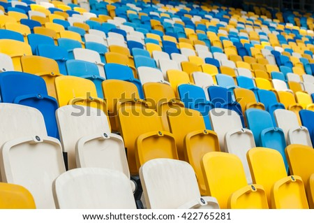 Empty plastic seats in a footbal or soccer stadium. 2016 sport background - stock photo