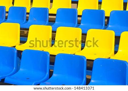 Empty plastic seats in a stadium  - stock photo