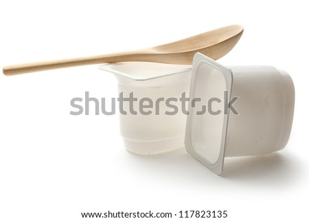 Empty plastic yoghurt pots with spoon
