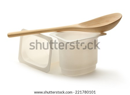 Empty plastic yogurt pots with wooden spoon