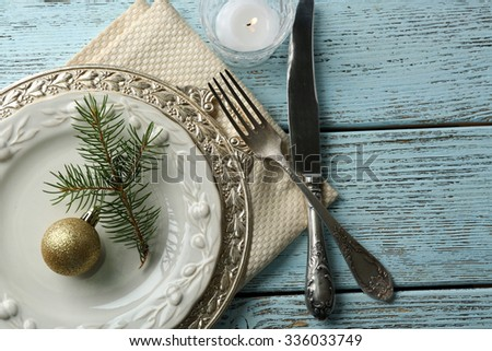 Empty plate, cutlery, napkin and glass on rustic wooden background. Christmas table setting concept - stock photo