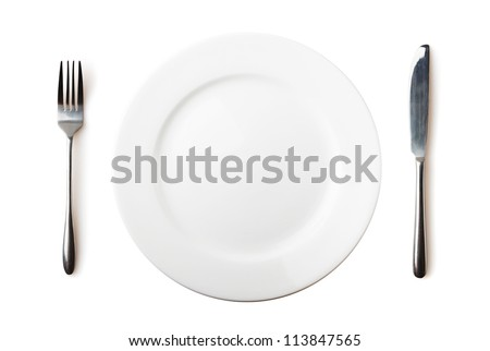Empty plate, fork and knife - isolated over white - stock photo