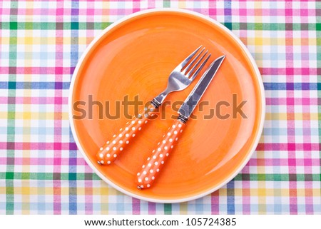 empty plate,knife and fork - stock photo
