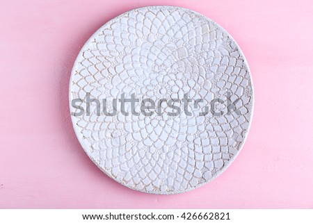 Empty plate on pink background - stock photo