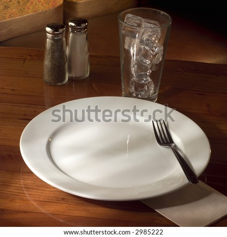 Empty plate on table. - stock photo