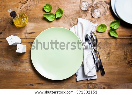 empty plate on table - stock photo