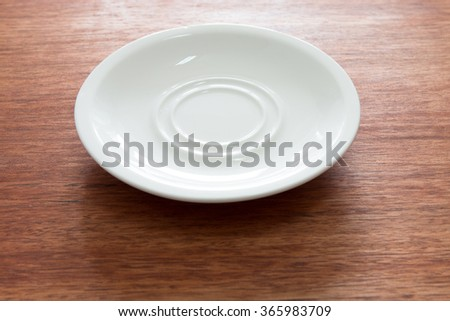 Empty plate on the wooden table - stock photo
