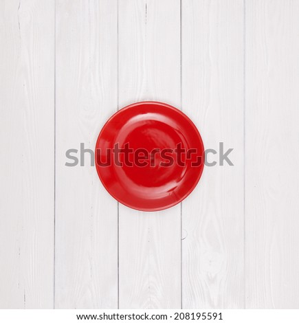 Empty plate on white wood - stock photo