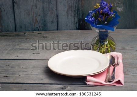 Empty plate on wooden background - stock photo