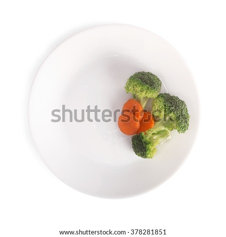 empty plate with carrot and broccoli waiting for food - stock photo