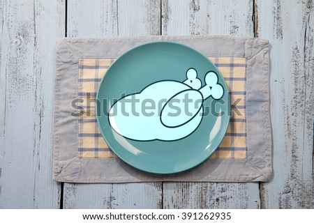 Empty plate with chicken meat sign on light blue wooden background - stock photo