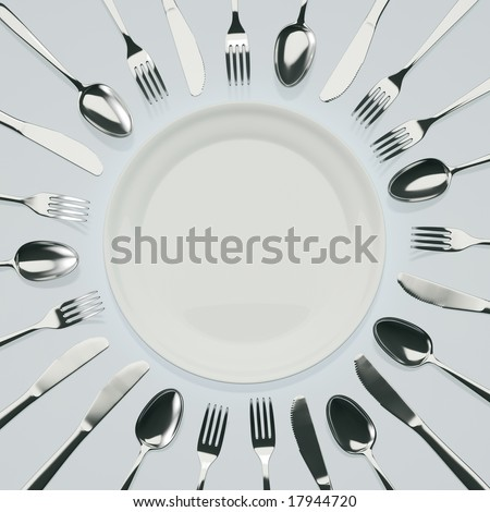 Empty Plate with Knives, Forks and Spoons Around - stock photo