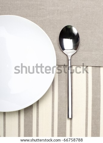empty plate with spoon - stock photo