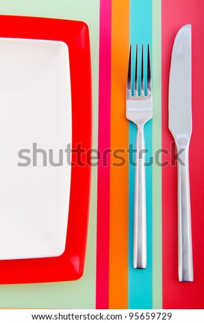 Empty plate with utensils - stock photo