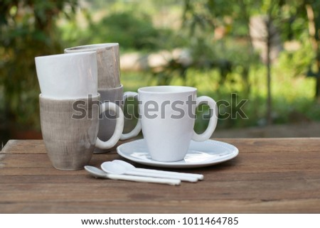 empty plates and bowls, kitchenware on wooden background.