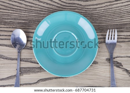 Empty plates and cutlery set aside