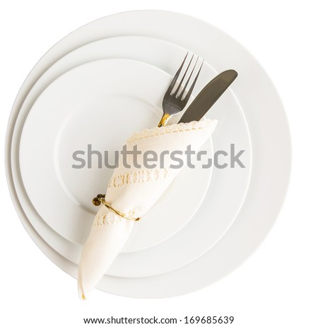 Empty plates with fork, knife and napkin on white background - stock photo