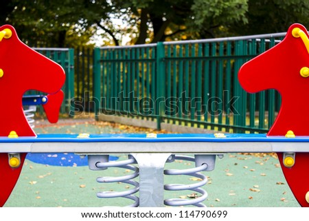 Empty playground in England during fall season/Empty playground/Outdoors - stock photo