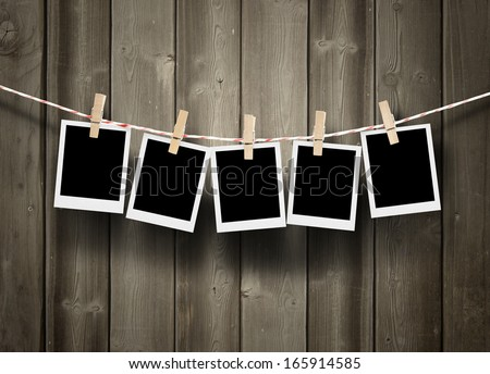 empty polaroid photos frames on wood background  - stock photo