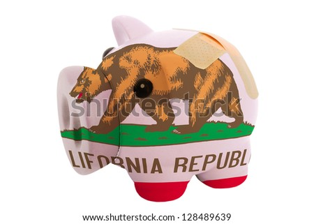 empty poor man piggy rich bank in colors flag of us state of california on white - stock photo