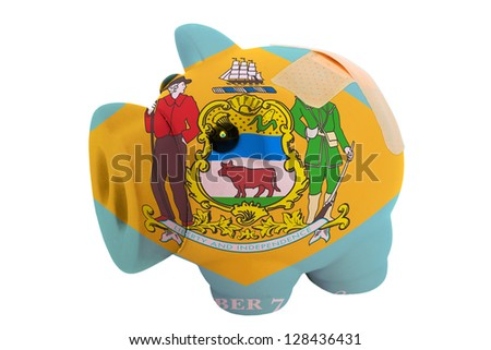empty poor man piggy rich bank in colors flag of us state of delaware on white - stock photo