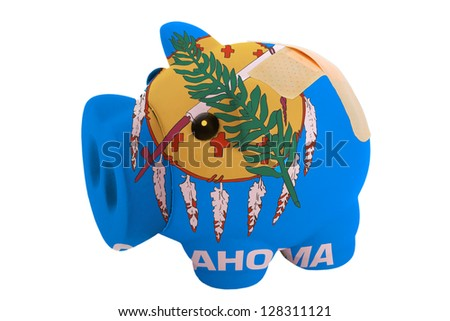 empty poor man piggy rich bank in colors flag of us state of oklahoma on white - stock photo