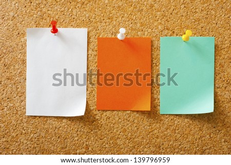 empty post its with pins on memo board - stock photo