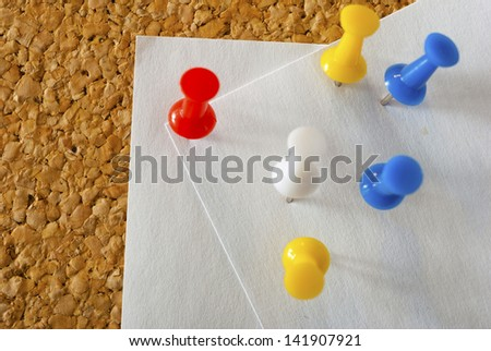 empty post its with pins on memo board