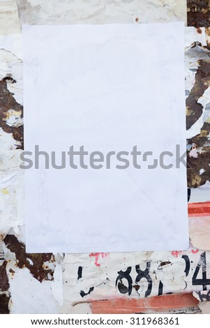 Empty poster on grunge wall. - stock photo
