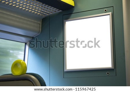 Empty poster on train - stock photo