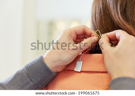 Empty price tag on necklace in a jewelry store - stock photo