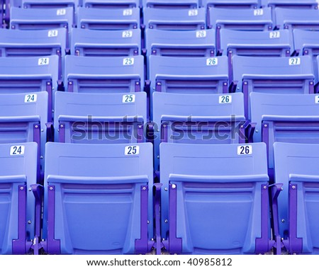 empty purple  folding stadium seats - stock photo
