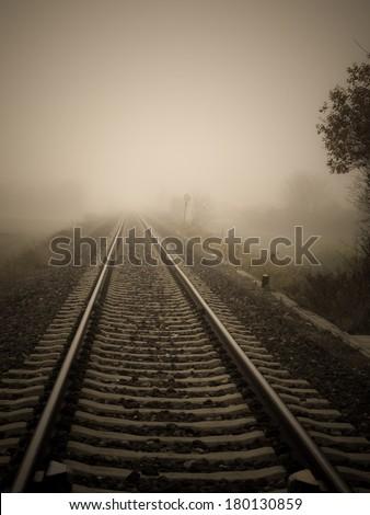 Empty railway in the fog - stock photo