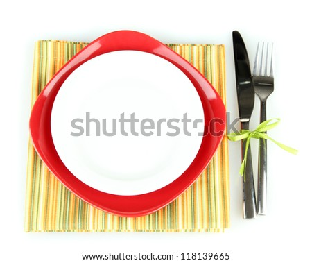 Empty red and white plates with fork and knife isolated on white - stock photo