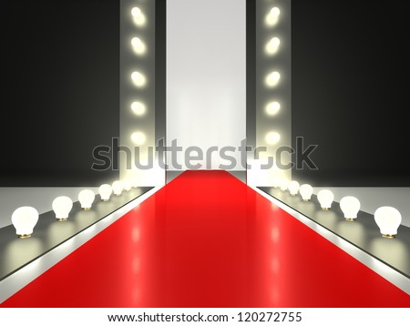 Empty red carpet, fashion runway illuminated by glowing light - stock photo