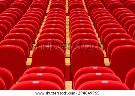 empty red chairs in a theater or cinema - stock photo