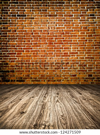 Empty red old spacious room with stone grungy wall and wooden weathered dirty floor, vintage background texture of brickwall - stock photo