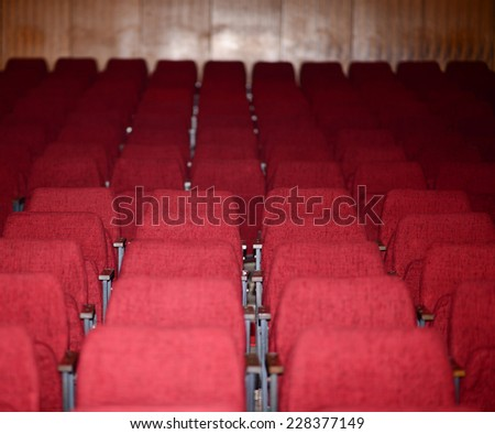 Empty red seats for cinema theater conference or concert - stock photo