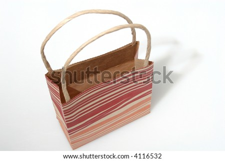Empty red striped paperbag isolated on white - stock photo