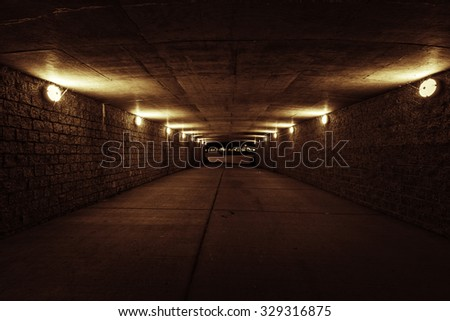 Empty red tunnel at night