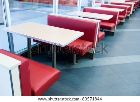 Empty restaurant interior with stage waiting for customers. - stock photo