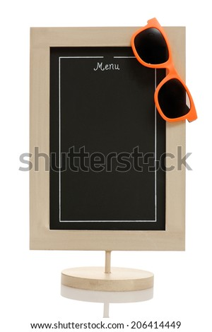 Empty restaurant menu chalkboard with orange sunglasses isolated on white. Conceptual image - summer menu, beach menu.