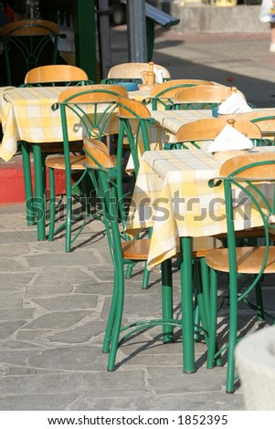 Empty restaurant tables waiting for new customers