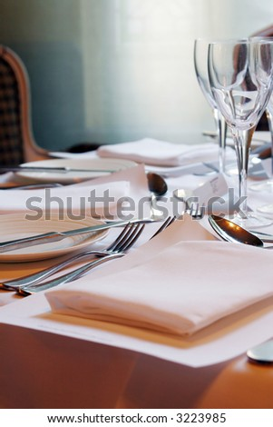 Empty restaurant with set tables - stock photo