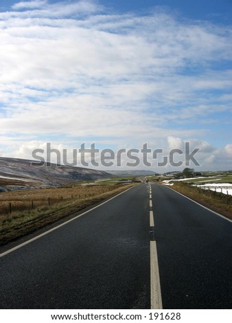 Empty road across the Yorkshire Dales, UK