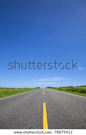 empty road and blue sky - stock photo